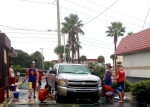 Cadets spend a Saturday morning raising money for the program at the Car Wash