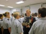 Platoon Sergeant Parnell inspects fourth squad on Uniform Day